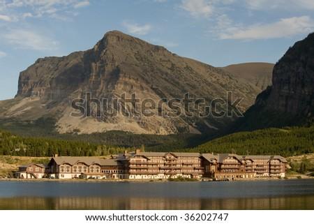 Historical lodge at Many Glacier lake at Glacier National park - stock photo