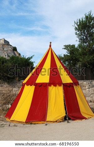historical medieval camp tent red and yellow - stock photo