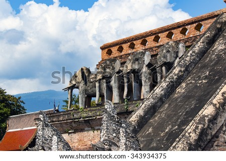 historical monument of Buddhist temple Wat Chedi Luang in Chiang Mai province of Thailand - stock photo