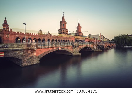 historical Oberbaum bridge (Oberbaumbruecke) and the river Spree in Berlin, Germany, Europe, vintage filtered style - stock photo