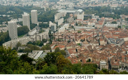 Historical old center and new modern age of Grenoble - stock photo