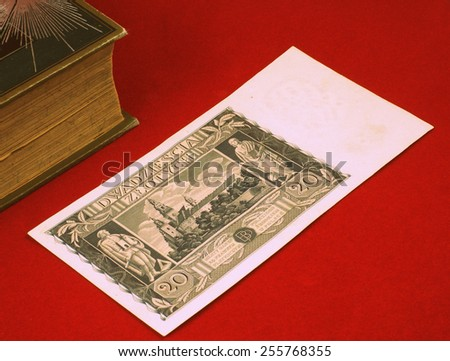 Historical, old Polish notes (1919 - 1940), bills on the red carpet background next to old book - classic photo style, focus on some part of the image only.