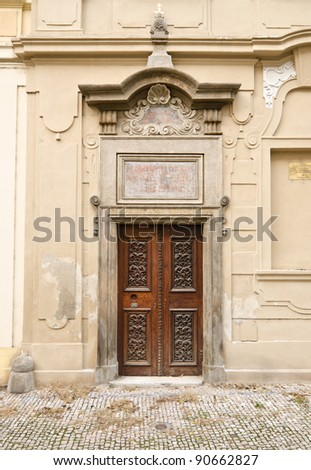 Historical Ornate Wooden Door in a Decorated Facade, Prague, The Czech Republic - stock photo