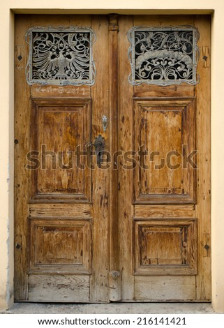 Historical Ornate Wooden Door in a Stone Entry, Prague, The Czech Republic - stock photo