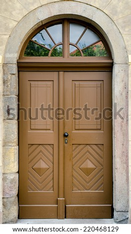 Historical Ornate Wooden Door in a Stone Entry with Arc and Glass Panes, Prague, The Czech Republic - stock photo