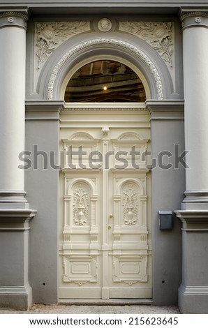 Historical Ornate Wooden Door in a Stone Entry with Arc and Pillars, Prague, The Czech Republic - stock photo