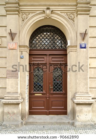 Historical Ornate Wooden Door with Glass Panes, Prague, The Czech Republic - stock photo