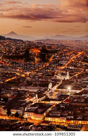 HISTORICAL PART OF QUITO, CAPITAL OF ECUADOR AS SEEN FROM PANECILLO STATUE AT DUSK OVERWORKED IN POST PROCESSING FOR BETTER VISUAL IMPACT   - stock photo