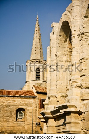 Historical Roman Arena and tower of church in Arles, Provence, France - stock photo