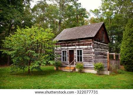 Historical Rustic Pioneer Log Cabin House Ontario Canada - stock photo