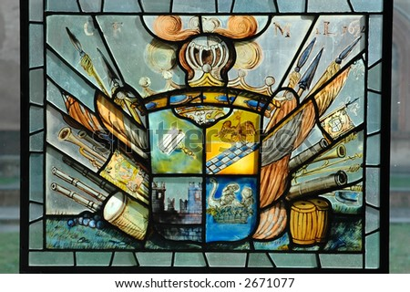 Historical stained glass window with heraldry symbol - stock photo