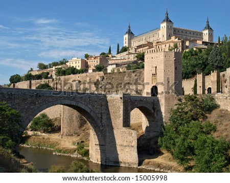 Historical Toledo view, bridge over Tagus and Alcazar fortified palace, Spain - stock photo