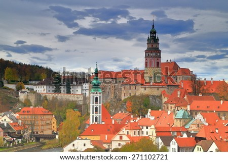 Historical town of Cesky Krumlov with medieval church and castle in cloudy day, Czech Republic - stock photo