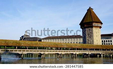 historical wooden Chapel Bridge and tower in Lucerne, Switzerland