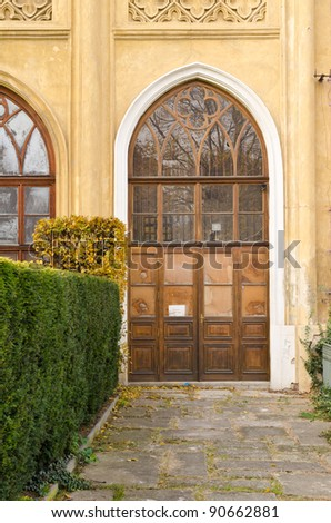 Historical Wooden Door with Glass Panes and Bushes Around, Prague, The Czech Republic - stock photo
