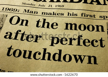 History. Close-up of the headline from a paper, the day after the first man landed on the Moon. - stock photo