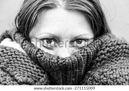 Hit girl with eyes covered with clothing - stock photo