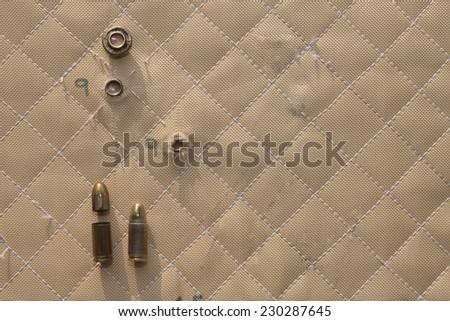 hit shot 9mm in Kevlar bulletproof vest - stock photo