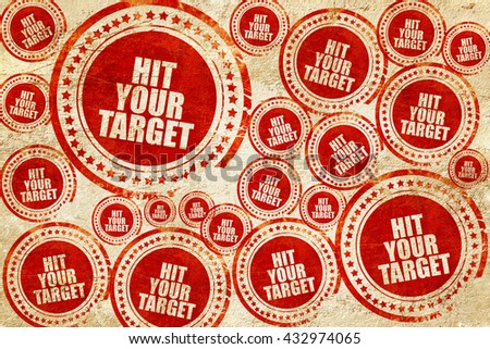 hit your target, red stamp on a grunge paper texture - stock photo
