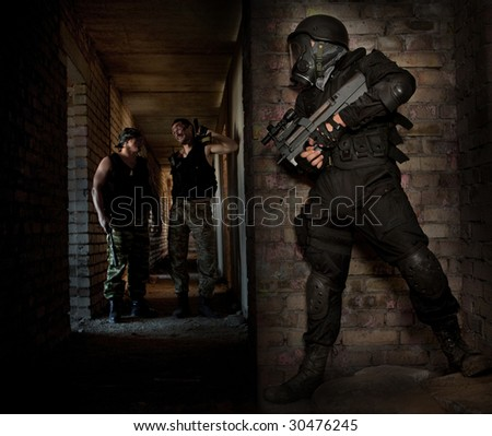 Hitman in a mask with the machinegun is waiting for victims - stock photo