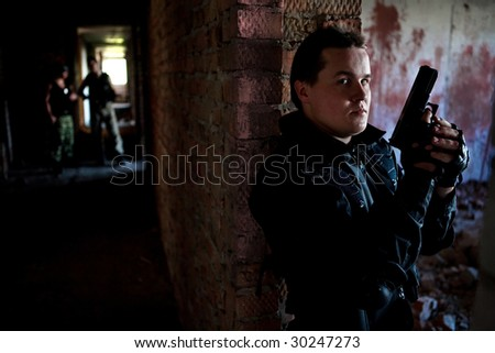 Hitman with a gun  is waiting for victims. - stock photo