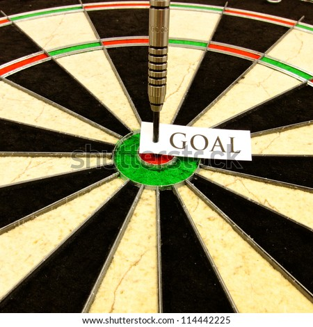 Hitting a conceptual bullseye that represents a business, finance, or personal goal - stock photo