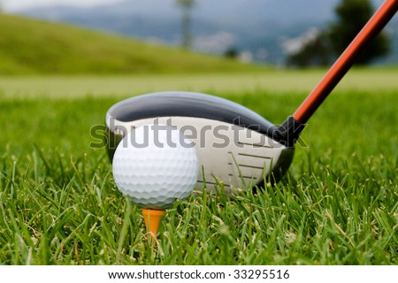 Hitting the ball with a club. - stock photo