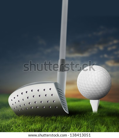 Hitting the golf ball during sunset in the field - stock photo