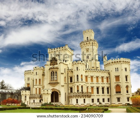 Hluboka castle over dramatic blue sky, Czech Republic - stock photo
