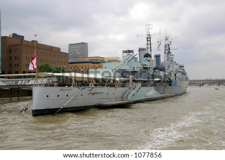 HMS Belfast berthed on the Thames River in London, England serving as a museum. - stock photo