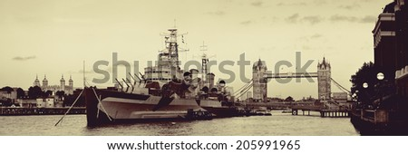 HMS Belfast warship and Tower Bridge in Thames River in London  - stock photo