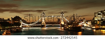 HMS Belfast warship and Tower Bridge panorama in Thames River in London  - stock photo