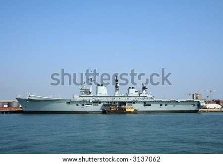 HMS Illustrious (R06), an Invincible class aircraft carrier in Portsmouth harbour - stock photo