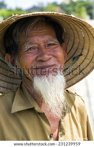 Ho Chi Minh City, Mekong Delta/Vietnam - November 10 2014: Ho Chi Minh Look-A-Like Posing for Tourists in a Rice Field in the Mekong Delta of Vietnam - stock photo