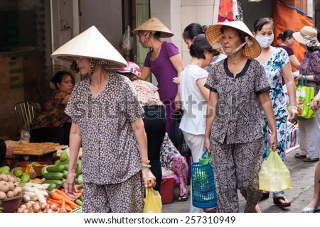 Ho Chi Minh City-Nov 3rd 2013: Shoppers at a street market. Early morning street markets are everywhere. - stock photo