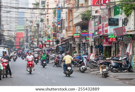 Ho Chi Minh City-Nov 1st 2013: Bui Vien Street. The street is a famous bachpacker and expat area of the city. - stock photo