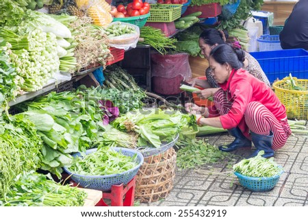 Ho Chi Minh City-Nov 1st 2013: Vendors preparing vegetables for sale at Ben Thanh market. Ben Thanh is the main market in the city. - stock photo