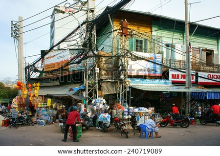 HO CHI MINH CITY, VIET NAM- DEC28: Amazing chemical store at Kim Bien market, electric pole in shop with wiring network, risk of burn, explode at residential, unsafe, danger life, Vietnam, Dec28, 2014 - stock photo