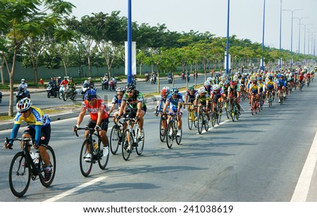 HO CHI MINH CITY, VIET NAM- JAN2: Amazing cycle race, sport activity to happy new year at Asia, rider wear helmet, ride bicycle in high speed, spirit, Vietnamese rider in action, Vietnam, Jan 2, 2014 - stock photo