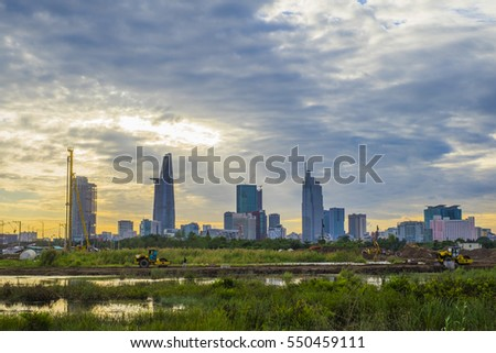 HO CHI MINH CITY, VIET NAM - JAN 07, 2017: Ho Chi Minh city (Sai Gon) in the golden hour twilight with beautiful color of light and cloudy sky. We can see Bitexco and many other buildings from here.