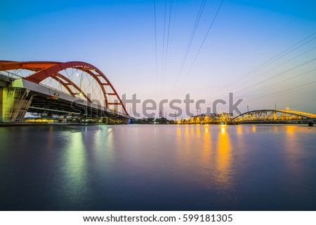 HO CHI MINH CITY, VIET NAM - MAR 13, 2017: Binh Loi bridge 1 and 2 in the same photo, Sai Gon, Viet Nam.