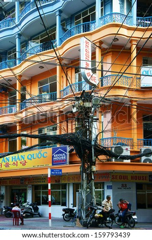 HO CHI MINH CITY, VIET NAM- OCTOBER 24: Colorful house of city and electric wire network in Sai Gon, VietNam, October 24, 2013                            - stock photo