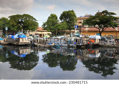 HO CHI MINH CITY, VIET NAM ON 14 AUGUST 2014: View of slum boat in Ho Chi Minh city. - stock photo