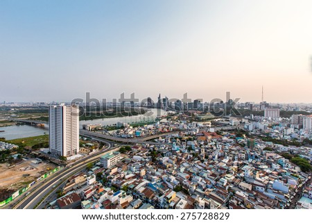 HO CHI MINH CITY, VIETNAM - APRIL 18, 2015: At sunset, with the sun saigon light shining through the rows of houses, the streets, Saigon make up with shimmering  - stock photo