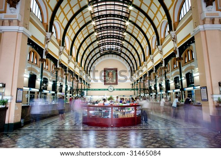 HO CHI MINH CITY, VIETNAM - April 12: Customers and tourists at the General Post Office on April 12, 2009. It was built by the French in the 1880s and is now a popular tourist attraction in Saigon, Vietnam. - stock photo