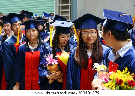 HO CHI MINH CITY, VIETNAM- AUG 8 : Group of student in gown uniform standing, wait for graduate ceremony at university, young human resources worryl face to unemployed situaion, Viet Nam,  Aug 5, 2014