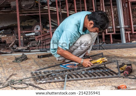 HO CHI MINH CITY, VIETNAM - AUGUST 30: Unidentied welder at work in Ho Chi Minh, Vietnam on August 30, 2014. - stock photo