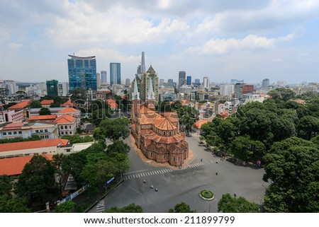 HO CHI MINH CITY / VIETNAM - CICAR AUGUST 2014 : Notre Dame Cathedral ( Saigon Notre-Dame Basilica )  located in the downtown of Ho Chi Minh City, Vietnam. - stock photo