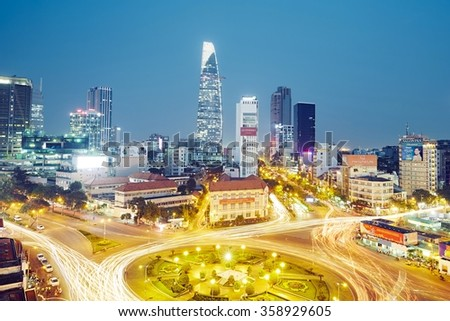 HO CHI MINH CITY, VIETNAM - DEC 16, 2015: Skyline and night traffic around Quach Thi Trang park in Ho Chi Minh City which is the largest city in Vietnam. - stock photo