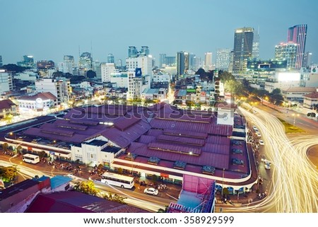 HO CHI MINH CITY, VIETNAM - DEC 16, 2015: Skyline and night traffic near Quach Thi Trang park in Ho Chi Minh City which is the largest city in Vietnam. - stock photo